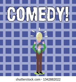 Text sign showing Comedy. Conceptual photo Fun Humor Satire Sitcom Hilarity Joking Entertainment Laughing Businessman Standing Raising Arms Upward with Lighted Bulb Icon on his Head.