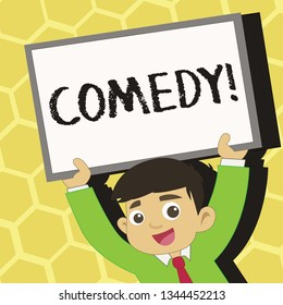 Text sign showing Comedy. Conceptual photo Fun Humor Satire Sitcom Hilarity Joking Entertainment Laughing Young Smiling Student Raising Upward Blank Framed Whiteboard Above his Head.