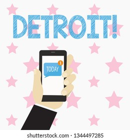 Text sign showing Detroit. Conceptual photo City in the United States of America Capital of Michigan Motown Human Hand Holding Smartphone with Numbered Unread Blank Message on Screen.
