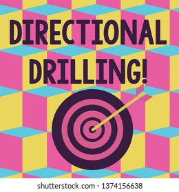 Text sign showing Directional Drilling. Conceptual photo drilling for oil which the well not drilled vertically Color Dart Board in Concentric Style with Arrow Hitting the Center Bulls Eye.