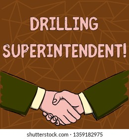 Text sign showing Drilling Superintendent. Conceptual photo responsibilities of drilling program oil well Businessmen Shaking Hands Firmly as Gesture Form of Greeting and Agreement.