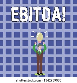 Text sign showing Ebitda. Conceptual photo Earnings Before Interest Taxes Depreciation Amortization Abbreviation Businessman Standing Raising Arms Upward with Lighted Bulb Icon on his Head.