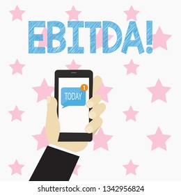 Text sign showing Ebitda. Conceptual photo Earnings Before Interest Taxes Depreciation Amortization Abbreviation Human Hand Holding Smartphone with Numbered Unread Blank Message on Screen.