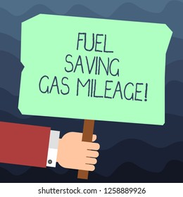 Text sign showing Fuel Saving Gas Mileage. Conceptual photo Expending less money in vehicle expenses gas savings Hu analysis Hand Holding Blank Colored Placard with Stick photo Text Space.