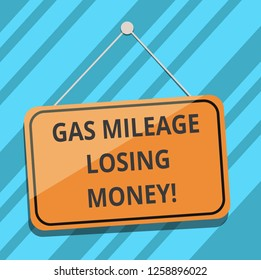 Text sign showing Gas Mileage Losing Money. Conceptual photo Long road high gas fuel costs financial losses Blank Hanging Color Door Window Signage with Reflection String and Tack.