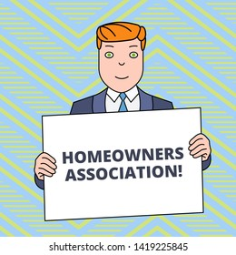 Text sign showing Homeowners Association. Conceptual photo Organization with fee for upkeeps of Gated Community Smiling Man Holding Formal Suit Big Blank Poster Board in Front of Himself.