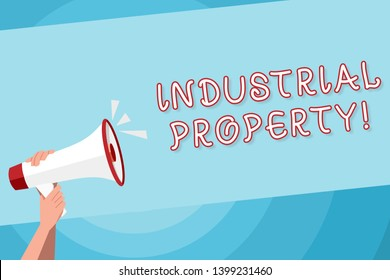 Text sign showing Industrial Property. Conceptual photo the intangible ownership of a trademark or patent Human Hand Holding Tightly a Megaphone with Sound Icon and Blank Text Space.