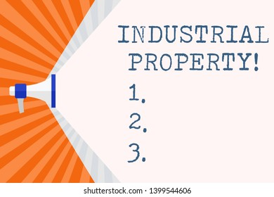 Text sign showing Industrial Property. Conceptual photo the intangible ownership of a trademark or patent Megaphone Extending the Capacity of Volume Range thru Blank Space Wide Beam.