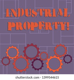 Text sign showing Industrial Property. Conceptual photo the intangible ownership of a trademark or patent Colorful Cog Wheel Gear Engaging, Interlocking and Tesselating Flat Style.