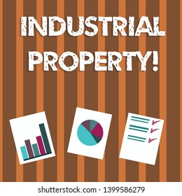 Text sign showing Industrial Property. Conceptual photo the intangible ownership of a trademark or patent Presentation of Bar, Data and Pie Chart Diagram Graph Each on White Paper.