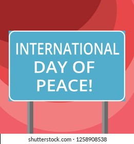 Text sign showing International Day Of Peace. Conceptual photo Worldwide peaceful celebration Hope freedom Blank Rectangular Outdoor Color Signpost photo with Two leg and Outline.