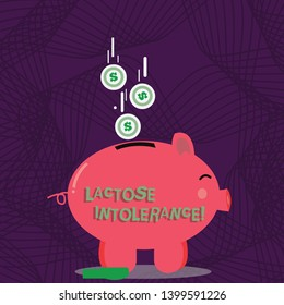 Text sign showing Lactose Intolerance. Conceptual photo digestive problem where body is unable to digest lactose Color Piggy Bank Sideview and Dollar Currency Coins Falling Down to the Slit.