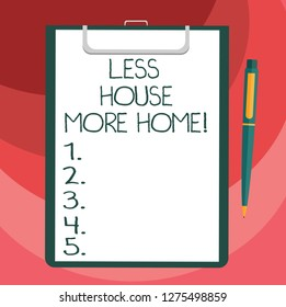 Text sign showing Less House More Home. Conceptual photo Have a warm comfortable place to live with family love Blank Sheet of Bond Paper on Clipboard with Click Ballpoint Pen Text Space.