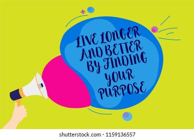 Text sign showing Live Longer And Better By Finding Your Purpose. Conceptual photo Look for a goal set mission Man holding Megaphone loudspeaker screaming talk colorful speech bubble.