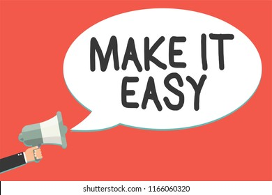 Text sign showing Make It Easy. Conceptual photo Smart approach Effortless Free from worries or difficulties Man holding megaphone loudspeaker speech bubble message speaking loud.