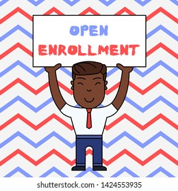 Text sign showing Open Enrollment. Conceptual photo The yearly period when showing can enroll an insurance Smiling Man Standing Holding Big Empty Placard Overhead with Both Hands.