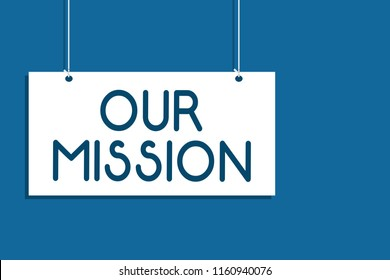 Text sign showing Our Mission. Conceptual photo tasks or schedule we need to made them right in order success Hanging board communicate information open close sign blue background.
