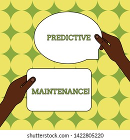 Text sign showing Predictive Maintenance. Conceptual photo Predict when Equipment Failure condition might occur Two Blank Figured Tablets Signs Held in Hands One Above Other Text Space.