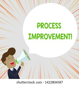 Text sign showing Process Improvement. Conceptual photo Optimization Meet New Quotas Standard of Quality Young Man Shouting into Megaphone Floating Round Shape Empty Speech Bubble.