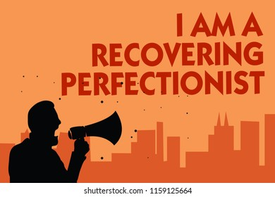 Text sign showing I Am A Recovering Perfectionist. Conceptual photo Obsessive compulsive disorder recovery Man holding megaphone speaking politician making promises orange background.