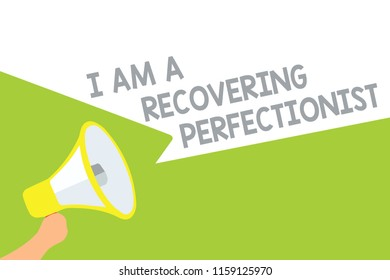 Text sign showing I Am A Recovering Perfectionist. Conceptual photo Obsessive compulsive disorder recovery Megaphone loudspeaker speech bubbles important message speaking out loud.