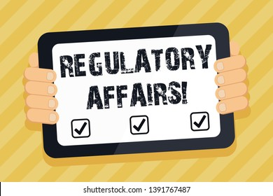 Text sign showing Regulatory Affairs. Conceptual photo the desire of governments to protect public health Color Tablet Smartphone with Blank Screen Handheld from the Back of Gadget.