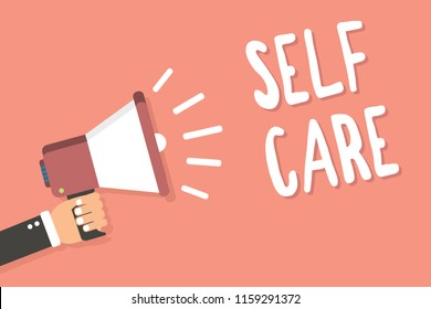Text sign showing Self Care. Conceptual photo Give comfort to your own body without professional consultant Man holding megaphone loudspeaker pink background message speaking loud.