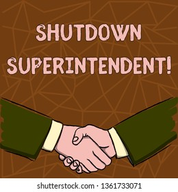 Text sign showing Shutdown Superintendent. Conceptual photo demonstrating who analysisages organization or activity Businessmen Shaking Hands Firmly as Gesture Form of Greeting and Agreement.