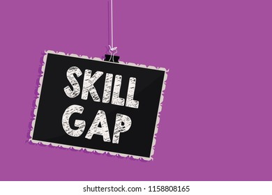Text sign showing Skill Gap. Conceptual photo Refering to a person's weakness or limitation of knowlege Hanging blackboard message communication information sign purple background.