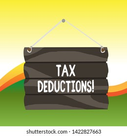 Text sign showing Tax Deductions. Conceptual photo reduction income that is able to be taxed of expenses Hook Up Blank Sign Plate. Empty Wooden Signboard with Lope for Hang.