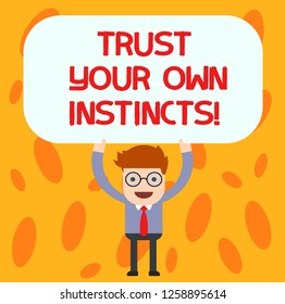 Text sign showing Trust Your Own Instincts. Conceptual photo Intuitive follow demonstratingal feelings confidence Man Standing Holding Above his Head Blank Rectangular Colored Board.