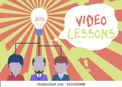 Text sign showing Video Lessons. Conceptual photo Online Education material for a topic Viewing and learning Group three executive persons sharing idea icon. Startup team meeting.