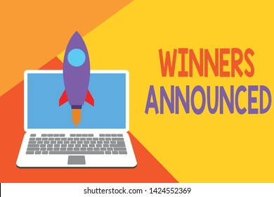 Text sign showing Winners Announced. Conceptual photo Announcing who won the contest or any competition Launching rocket up laptop . Startup project. Developing goal objectives.