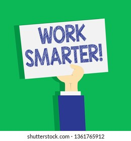 Text sign showing Work Smarter. Conceptual photo its better to efficient and productive than waste time Clipart of Hand Holding Up Blank Sheet of White Paper on Pastel Backdrop.
