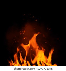 Texture of burn fire with particles embers. Flames on isolated black background.