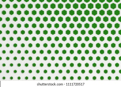 Texture of concrete honeycomb size from larger to smaller overgrown with green lawn. 3d illustration