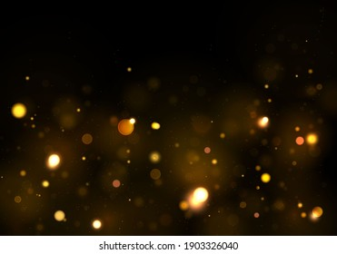 Texture glitter and elegant for Christmas. Sparkling magical gold yellow dust particles. Bokeh effect. Magic golden concept. Abstract black background.