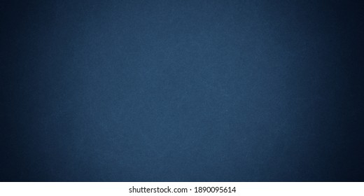 Texture of old navy grunge blue paper closeup