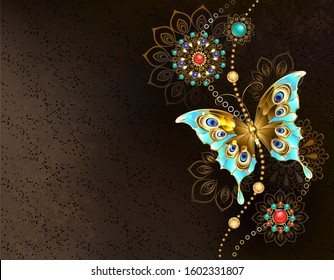 Textured brown background with jewelry turquoise butterfly and oriental ornaments.