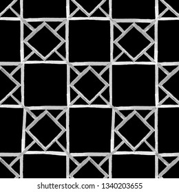 Textured seamless pattern. Hand paining. Repeating geometric tiles with squares and rhombuses black and white