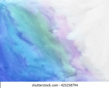 A textured watercolor background paper with blue green and purple color paint splashes and fringing on white.