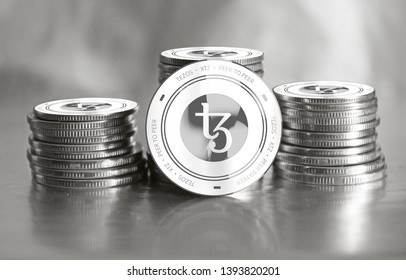 Tezos (XTZ) digital crypto currency. Stack of silver coins. Cyber money. 3D Render.