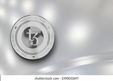 Tezos (XTZ) digital crypto currency. Silver coin. Cyber money. 3D Render.