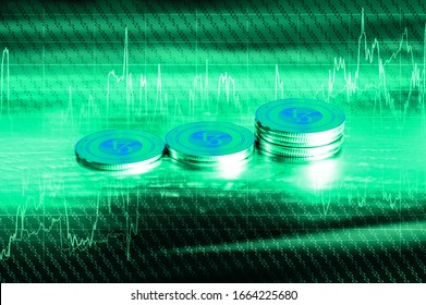 Tezos (XTZ) digital crypto currency. Сoins on the background of stock indexes. Cyber money. 3D Render.