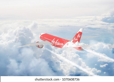 THAILAND, 21 MARCH 18: Aerial view of Air Asia cruising above Fluffy White Clouds. 3D Illustration.