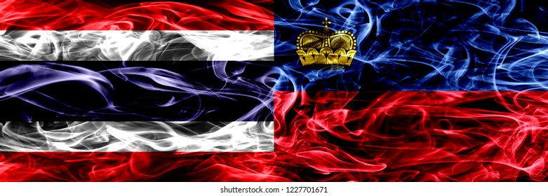 Thailand vs Liechtenstein, Liechtensteins smoke flags placed side by side. Thick abstract colored silky smoke flags