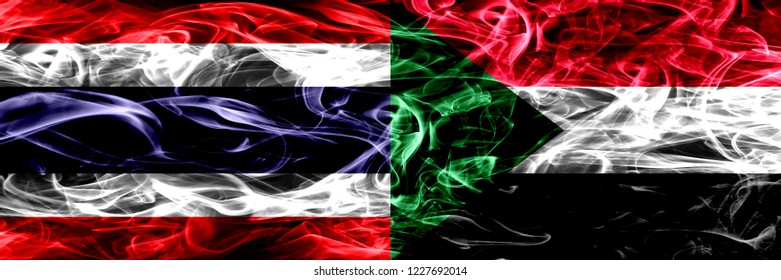 Thailand vs Sudan, Sudanese smoke flags placed side by side. Thick abstract colored silky smoke flags