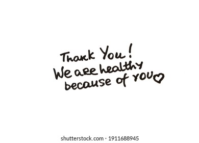 Thank you! We are healthy because of you! Handwritten message on a white background.