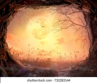 Thanksgiving concept: Cave stone with death tree on full moon in autumn night background - 3D illustration