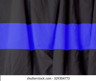 The thin blue line. Police camaraderie and represented when an officer dies and the dangers of their job.